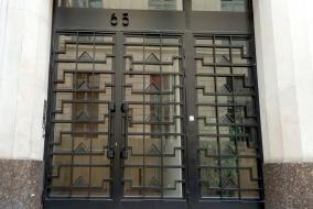 Entrance at 65, Rue de Richelieu, ironwork by Raymond Subes